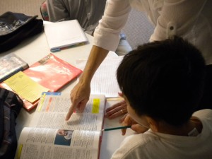 Picture of teacher helping child with homework